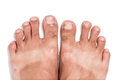 Mark of sunburn on bare foot with clipping path white background Stock Photo