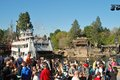 The mark twain riverboat loaded with passengers at disneyland california tourists next to pirate s lair on tom sawyer s island on Royalty Free Stock Photos