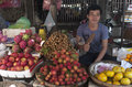 Market of kompong cham cambodia a man selling fruit in the Stock Photos