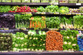 Market produce variety of fresh vegetables on display in shelves Royalty Free Stock Photos