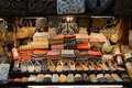 Market stall dubai a sells souveniers at the landmark madinat jumeirah in in the emirates shoes shawls bags Stock Image