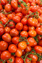 Market stall with lots of tomatoes Stock Photos