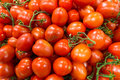 Market stall with lots of tomatoes Royalty Free Stock Photography