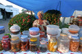 Market tradeswoman in her market stall surinam city capital paramaribo creole woman acid saleswoman seller of fruits and Stock Image