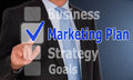 Marketing plan text business strategy goals on computerized touch screen with highlighted in blue with blue check Stock Photo