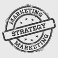 Marketing strategy rubber stamp on white.