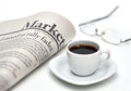 Markets newspaper with coffee and cup of on white background shallow depth of field Royalty Free Stock Images