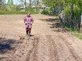 Marking furrows woman gardener work with homemade furrow marker Royalty Free Stock Photos