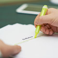 Marking words in a deflation definition shallow depth of field composition Stock Photo