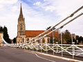 Marlow england all saints church seen from the suspension bridge over the river thames in buckinghamshire Royalty Free Stock Photos