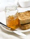 Marmalade breakfast with toast on a tabletop Royalty Free Stock Image