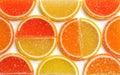 Marmalade lemon orange and grapefruit slices background close up Royalty Free Stock Photo