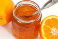Marmalade and oranges clouseup shot of orange on white background Royalty Free Stock Images