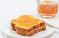 Marmalade on toast toasted white bread with orange horizontal composition Stock Image