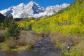 Maroon bells amazement a girl with arms raised in and wonder at the scenic aspen colorado in fall Royalty Free Stock Photography