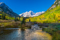 Maroon bells in autumn snow covered and fall aspens near aspen colorado Stock Image