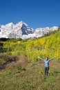 Maroon bells awe a girl with arms raised in freedom and wonder at the scenic aspen colorado in fall Stock Photography