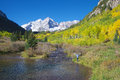 Maroon bells freedom a girl with arms raised in amazement and wonder at the scenic aspen colorado in fall Stock Images