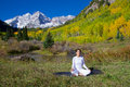 Maroon bells meditation a woman meditating at the scenic aspen colorado in fall Royalty Free Stock Photography