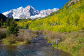 Maroon bells praise a girl with arms raised in and wonder at the scenic aspen colorado in fall Stock Photos