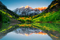 Maroon bells reflections at lake sunrise Royalty Free Stock Photos