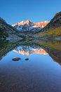 Maroon bells sunrise aspen colorado vertical composition reflect and its reflection in the lake with fall foliage in peak at Royalty Free Stock Images