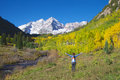 Maroon bells wonder a girl with arms raised in freedom and at the scenic aspen colorado in fall Royalty Free Stock Image