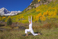 Maroon bells yoga in autumn a woman practicing the scenic colorado mountains fall Royalty Free Stock Photos