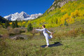 Maroon bells yoga dance pose a woman practicing in the scenic colorado mountains in fall Stock Images
