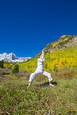 Maroon bells yoga pose a woman practicing in the scenic colorado mountains in fall Royalty Free Stock Photography