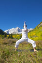 Maroon bells yoga posing a woman practicing in the scenic colorado mountains in fall Royalty Free Stock Images