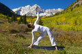 Maroon bells yoga practice a woman practicing in the scenic colorado mountains in fall Royalty Free Stock Images
