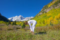 Maroon bells yoga stretch a woman practicing in the scenic colorado mountains in fall Stock Photos