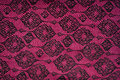 Maroon fabric with black patterns background or texture Stock Photo