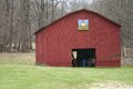 Maroon quilt barn a with a block attached Stock Photo
