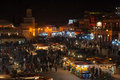 Marrakesh at night morocco jan people shopping in the evening famous square djemaa el fna on january in morocco the Royalty Free Stock Photo