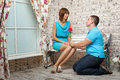 Marriage proposal man proposes to his girlfriend and gives a beautiful bouquet Royalty Free Stock Images