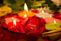 Marriage proposal message with candles and the written rose petal Stock Photo