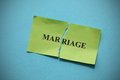 Marriage rift broken torn of paper with the word concept image close up Stock Photography