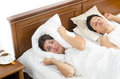 Marriage secrets a snorer men and a tired women trying to get some sleep Stock Image