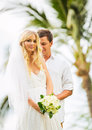 Married couple bride and groom getting married tropical weddin wedding in hawaii Royalty Free Stock Photo