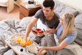 Married couple enjoying breakfast in bed Royalty Free Stock Photo