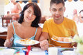 Married couple having breakfast at restaurant Stock Images