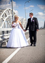 Married couple holding hands and walking on road newly Royalty Free Stock Image