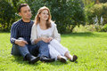 Married couple looking aside outdoors Royalty Free Stock Photo