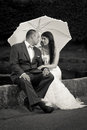 Married couple in the park with white umbrella Stock Image