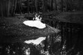 Married couple sitting on river bank black and white photo of Stock Images