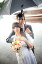 Married couple standing under umbrella closeup portrait of Stock Photos