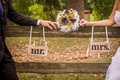 Married couple beside wooden fence Royalty Free Stock Image