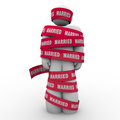 Married man wrapped red tape prisoner trapped person an unhappy is in with the word to illustrate being or caught in an unhappy Royalty Free Stock Photos